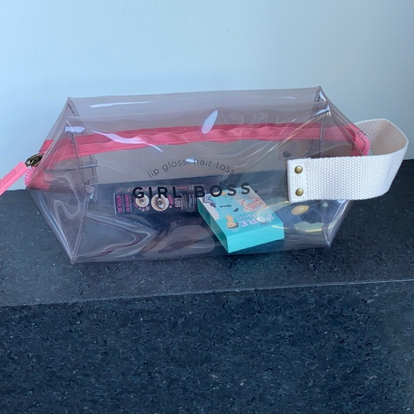 NWOT Benefit clear cosmetic pouch with 24 samples